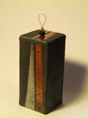 Lidded box with raku glaze