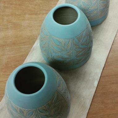 Freshly carved sgraffito pots